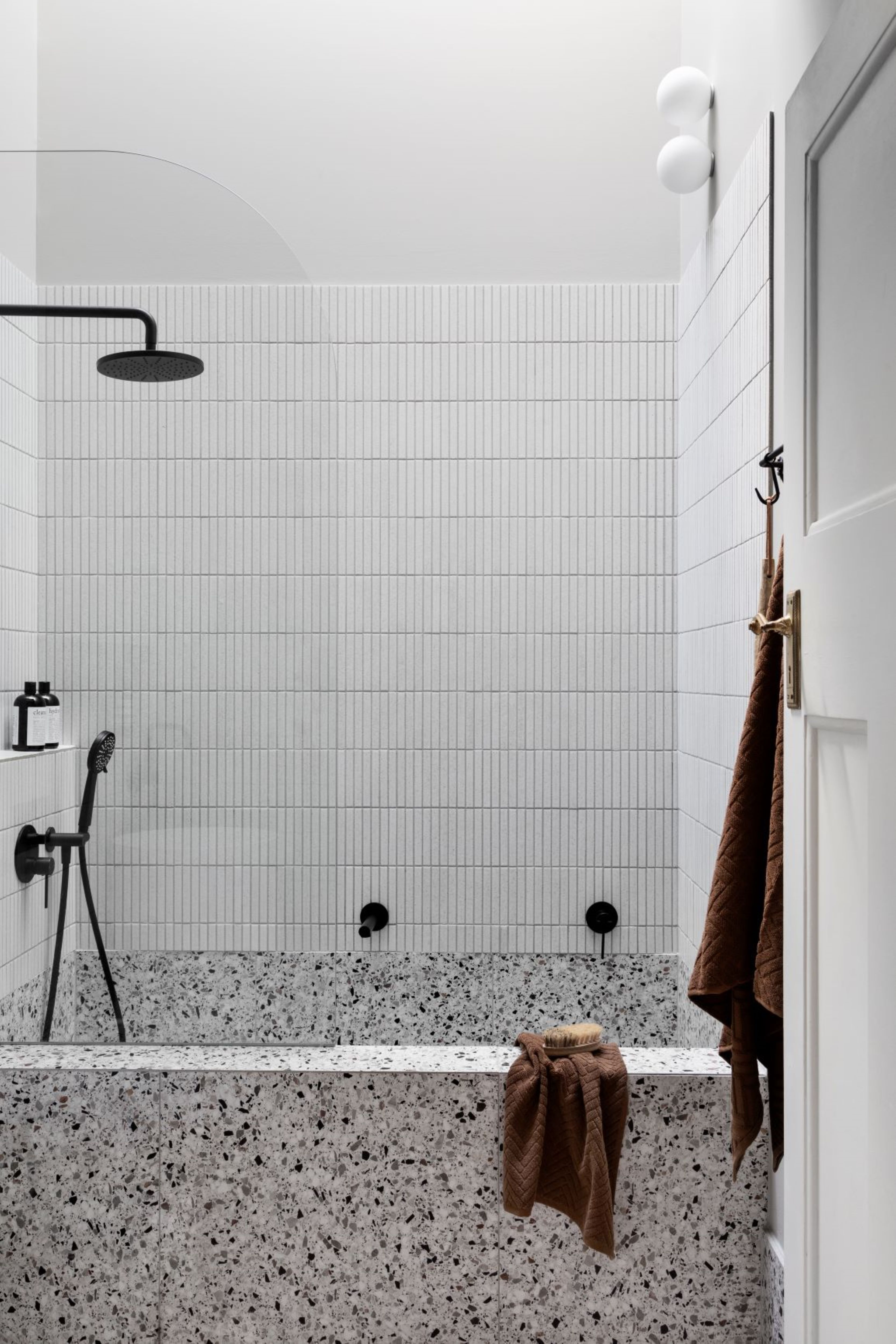 Alison Lewis Interiors Cecil Street Project Bathroom with bath hob and black tapware