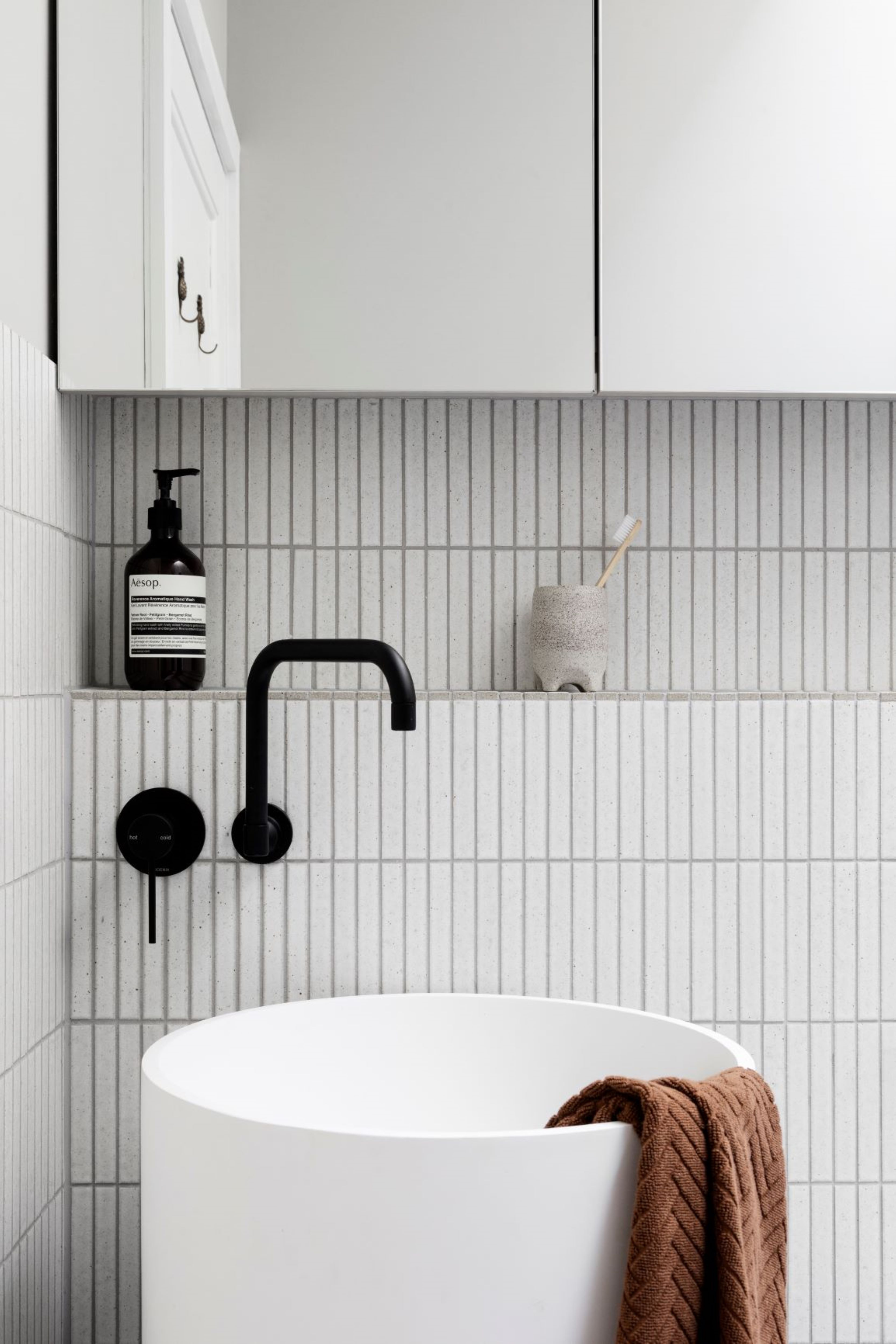Alison Lewis Interiors Cecil Street Project Round Basin with finger mosaic tiles