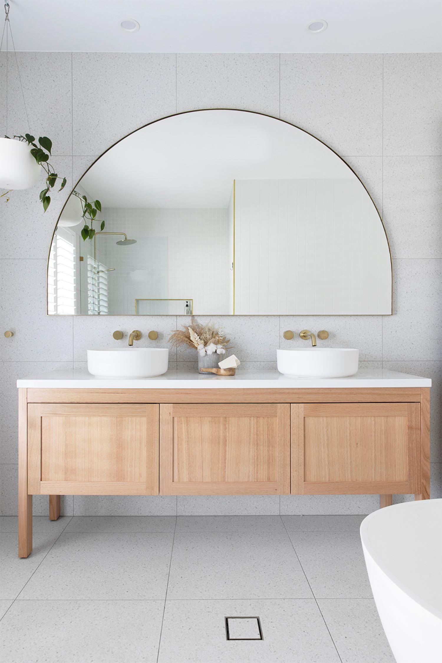 the-coastal-barn-dream-home-arched-bathroom-mirror