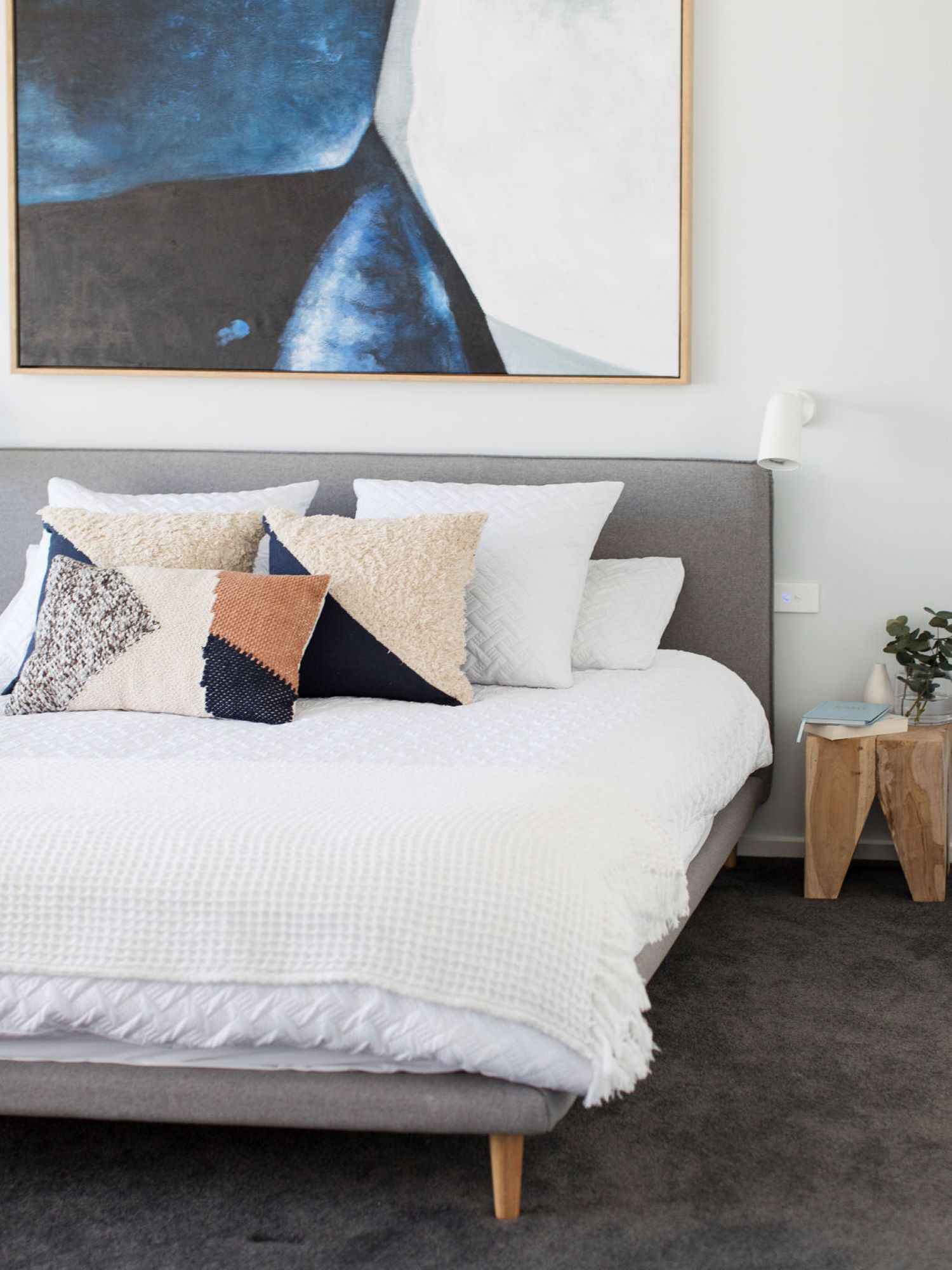 Modern Bedroom with large artwork by interior designer Michelle Canny